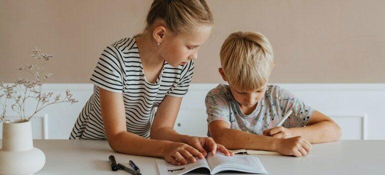 two kids writing