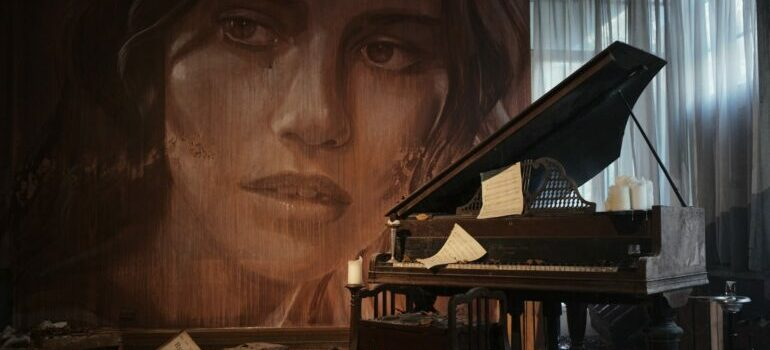 Rustic piano with a portrait of a woman behind it