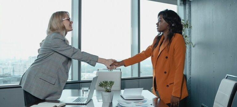 two women, office meeting, handshake