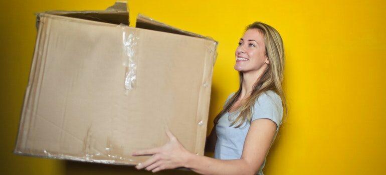 woman holding an old cardboard box