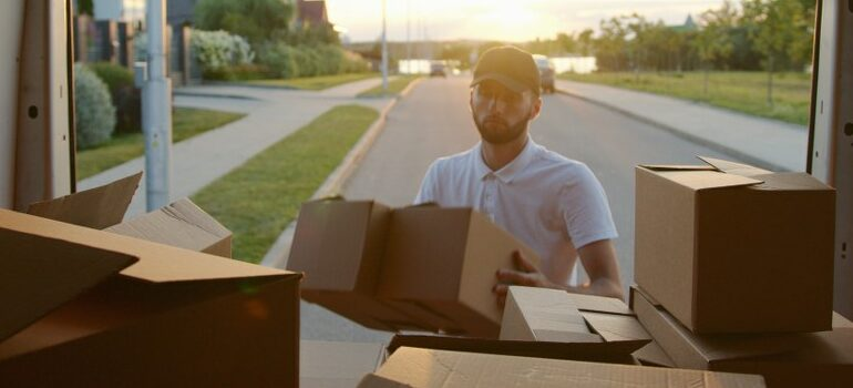 professional mover loading a moving van