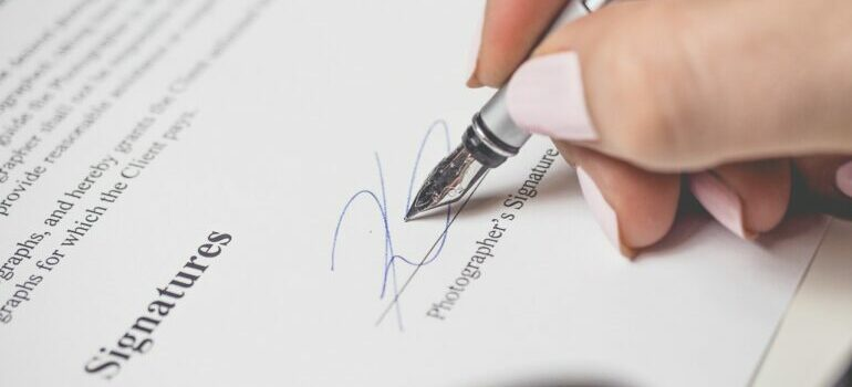 Person signing a contract