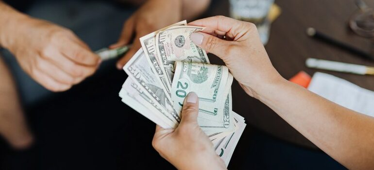 person holding dollars in hands