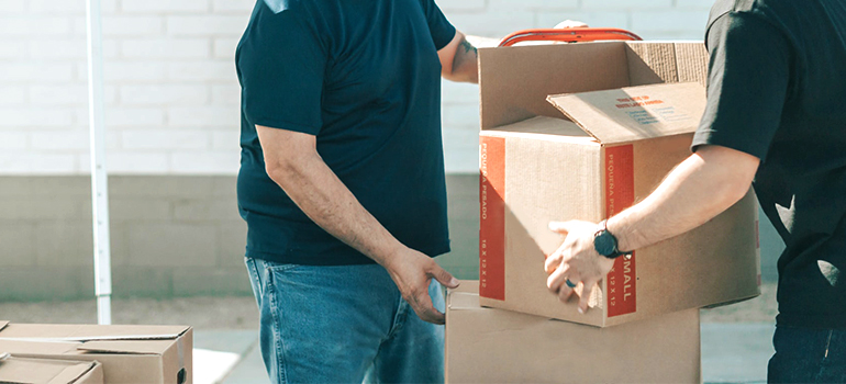 movers carrying boxes to storage North Austin