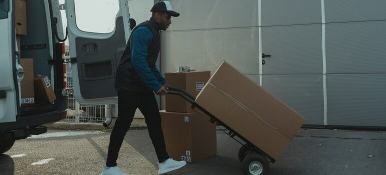 storage pickup and delivery using a dolly