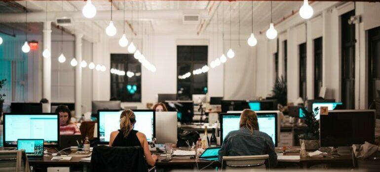 a group of employees working in an office