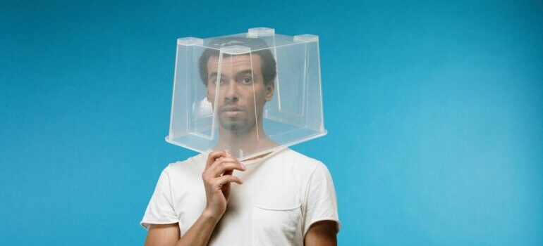 a man with a plastic box over his head