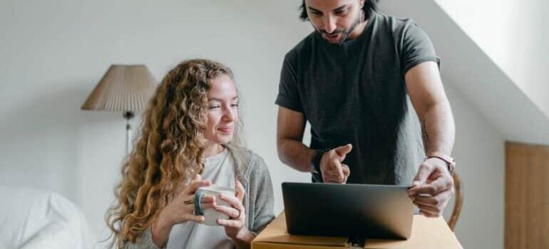 man woman and computer