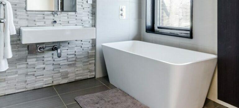 bathroom with gray tile flooring