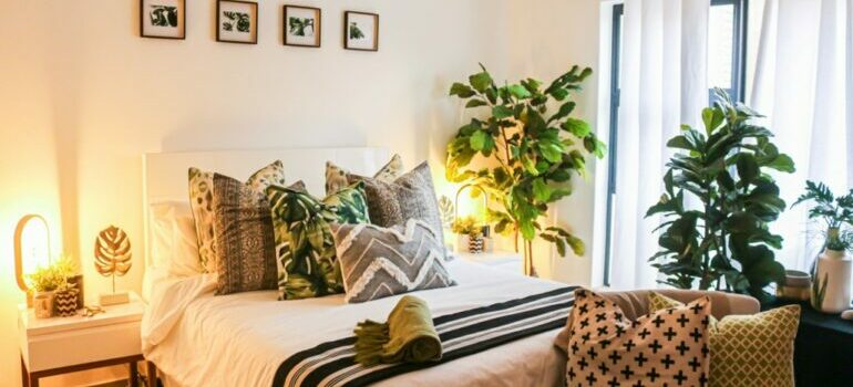 bedroom with plants and cozy pillows