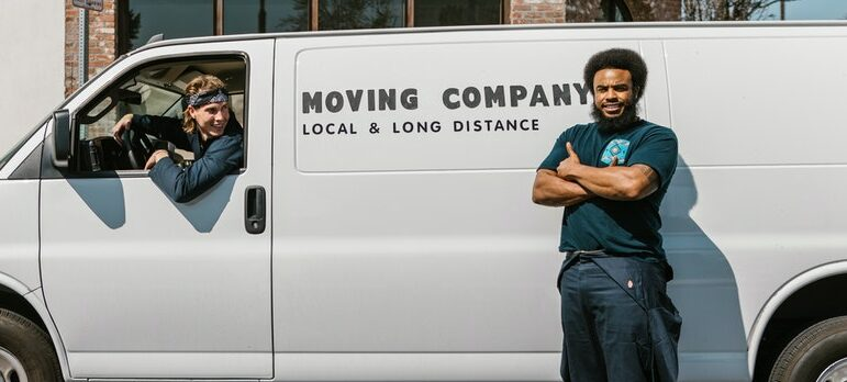 a man standing in front of a moving van