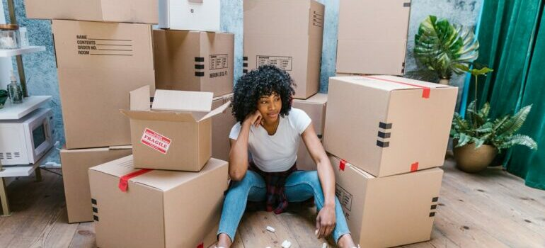 Young woman moving home