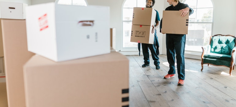 movers from storage pickup and delivery services in Austin holding boxes