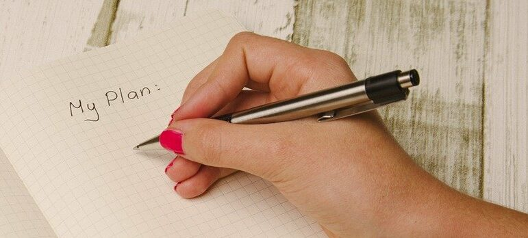 a hand writing on paper