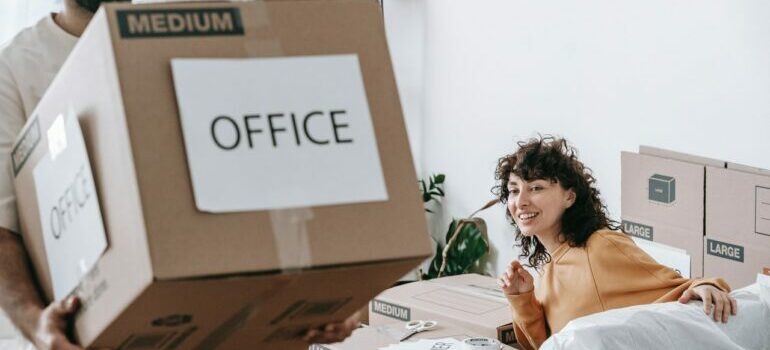 A couple packing their office for relocation in a day