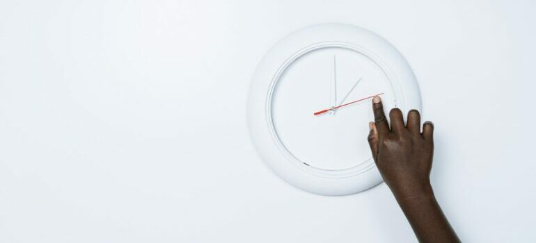 watch on the wall representing best time to move business