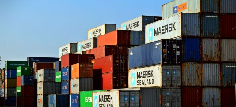 a large number of containers stacked on one another