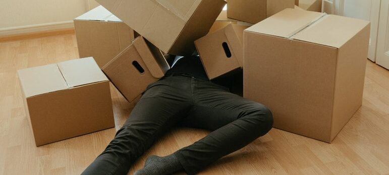 a person covered in cardboard boxes