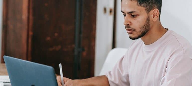 a man browsing laptop
